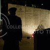 Emily DeShazer | The Collegian  Erica Iversen, senior in park management, stands guard at the Vietnam Memorial on November 11, 2013 during the twenty-four hour silent vigil. The names written on the memorial are K-State graduates that were killed or went missing in combat.