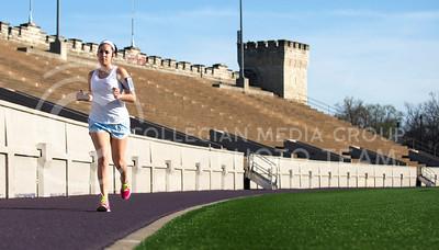 Lilia Flores, senior in public health nurtrition, jogs around Memorial Stadium yesterday evening.