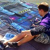 (Photo by Parker Robb | Collegian)  Nate Baranowski, owner of Street Canvas Design based out of Tampa Bay, Florida, draws mechanical parts on his sidewalk art October 10, 2013 in Bosco Plaza.  Students are encouraged to interact with the three-dimensional piece once it is finished Friday.