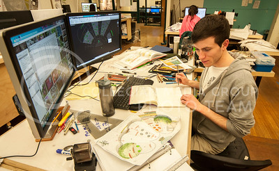 Hannah Hunsinger | The Collegian Conner Bruns, sophomore in landscape design, works on his designs for an urban plaza in Seaton Hall late on March 4, 2014.