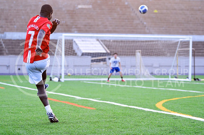 Parker Robb | The Collegian  Allan Ddamulira, sophomore in biological systems engineering, takes a shot at goalie Alonso Acevedo, sophomore in biochemistry, as the two practice taking shots on goal and saving those shots, respectively, at Old Stadium May 5, 2014.
