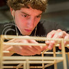 Emily DeShazer | The Collegian  Gluing beams and struts together Jonathan Cascioli, a freshman in architecture, builds his model for his complex space project on November 12, 2013.  Cascioli said he expected to spend all night in the basement of Seaton Hall working on his project, along with about 50 other students.
