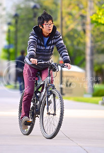 Parker Robb | The Collegian  Jianting Huang, first year Ph.D. student in mathematics, cruises across campus on her bike April 30, 2014. The City of Manhattan is celebrating its fifth-annual Bike Month this May.