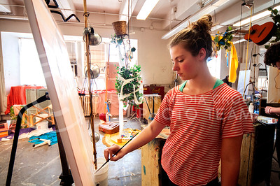 Anne Benest, senior in art, works on a still life painting in Intro to Oil Painting in Willard Hall yesterday afternoon.