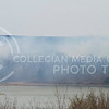 (Photo by Taylor Alderman | Collegian)<br /> <br /> The wind blows the smoke over Pottawatomie Lake #2 as farmers burn away weeds to refreshen the land on April 10th, 2014.