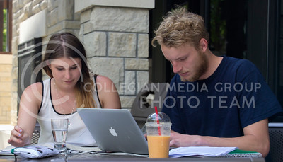 (Photo by Taylor Alderman | Collegian)  Genevieve Vetten, junior in mechanical engineering, and Michael Harris, junior in pre-law and entrepreneurship, studying outside of the Leadership Studies' building on May 6, 2014. There are numerous locations available for student studying for finals week.