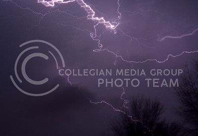 (Photo by George Walker | Collegian)  Lightning flashes across the sky southwest of Manhattan during the thunderstorm that popped up last night.