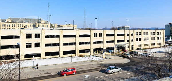 Photo by Parker Robb | The Collegian  Cars enter and exit the parking garage south of the K-State Student Union March 24, 2014. Those parking in the garage must now follow new entry procedures, scanning their parking passes, as the garage just installed new equipment.