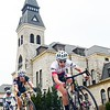 Parker Robb | The Collegian<br /> <br /> Cyclists competing in the men's category 1/2/3 USA Cycling Campus Criterium fly by Anderson Hall in their one mile circuit of the east side of the K-State campus April 6, 2014. The KSU Cycling Club hosted the Wildcat Grand Prix over the weekend, hosting both USAC races and the North & South Central Collegiate Championship races on an 18-mile-lap road course beginning in Randolph Saturday, and on the criterium course around the K-State campus Sunday.