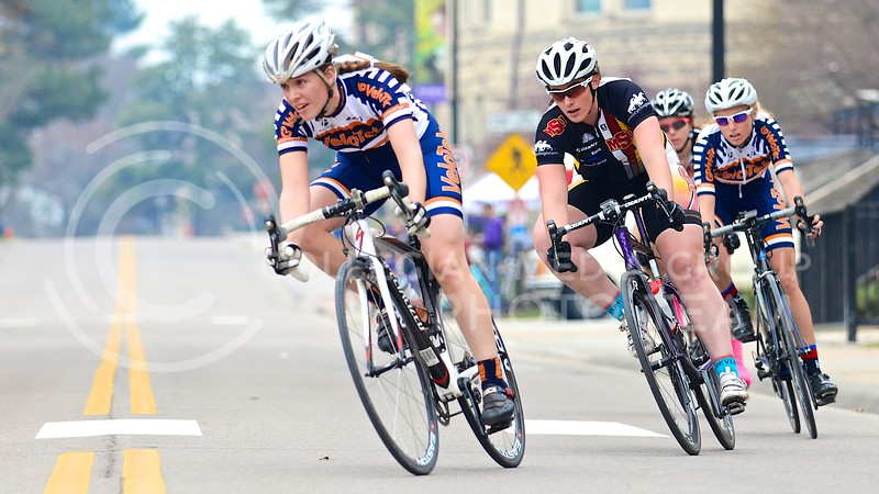 Parker Robb | The Collegian<br /> <br /> Women racing in the USAC top women's category criterium of the Wildcat Grand Prix prepare to take a wide, fast corner in front of the Leadership Studies Building April 6, 2014.