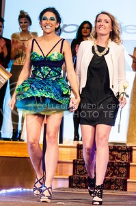 Photo by Parker Robb | The Collegian  Arianna Levin, junior in apparel and textile design, walks down the runway with Sophia Alonso, senior in life sciences, modeling Levin's winning dress, to collect her prize for winning K-State Project Runway, Season 5: Hunger Games Challenge March 3, 2014. Faculty are not allowing Levin to enter her conservative lingerie designs in the Apparell & Design Showcase of Excellence, citing inappropriateness, although swimsuit designs are fair game.