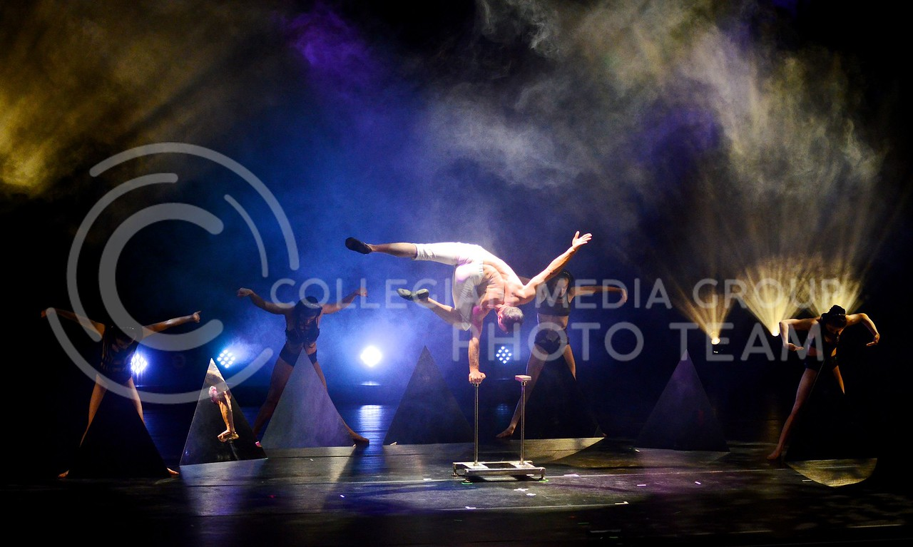 (Photo by Parker Robb   Collegian)<br /> <br /> Members of Quixotic perform acrobatics and choreographed dances to live music and surreal visual effects during their performance February 7, 2014, at McCain Auditorium. Quixotic, based out of Kansas City, combines dance, acrobatics, visual effects, live and recorded music, and fashion into one surreal and hypnotic experience.