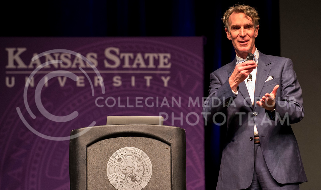 Photo by Hannah Hunsinger   Collegian<br /> Renowned scientist and childerns' show host Bill Nye speaks about his dad's fascination with sun dials, the Mars rovers and climate change in Bramlage Coliseum last night.  His humorous lecture was followed by questions from the audience.
