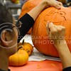 (Photo by Parker Robb | Collegian)  Sandra Contreras, graduate student in Agricultural Economics, carves a pumpkin with the image of Kirmit the Frog at the UPC After-Hours Fall Night October 26, 2013, at the Student Union.