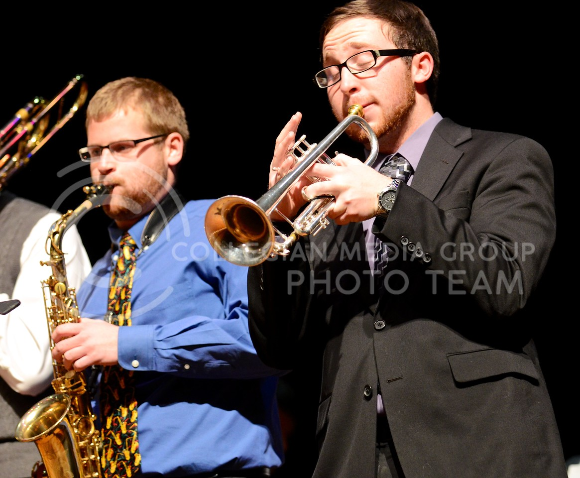 """(Photo by Parker Robb   Collegian)<br /> <br /> Members of the Powercat Brass Quintet perform the slow, peaceful tune """"Have Yourself a Merry Little Christmas"""" at the Holiday Music Spectacular held in Peace Memorial Auditorium attached to City Hall December 11, 2013. Several other groups, including the Latin Jazz Ensemble, In-A-Chord, and the Sinfonian Swingers, performed a cappella, percussion and jazz arrangements of loved Christmas carols."""