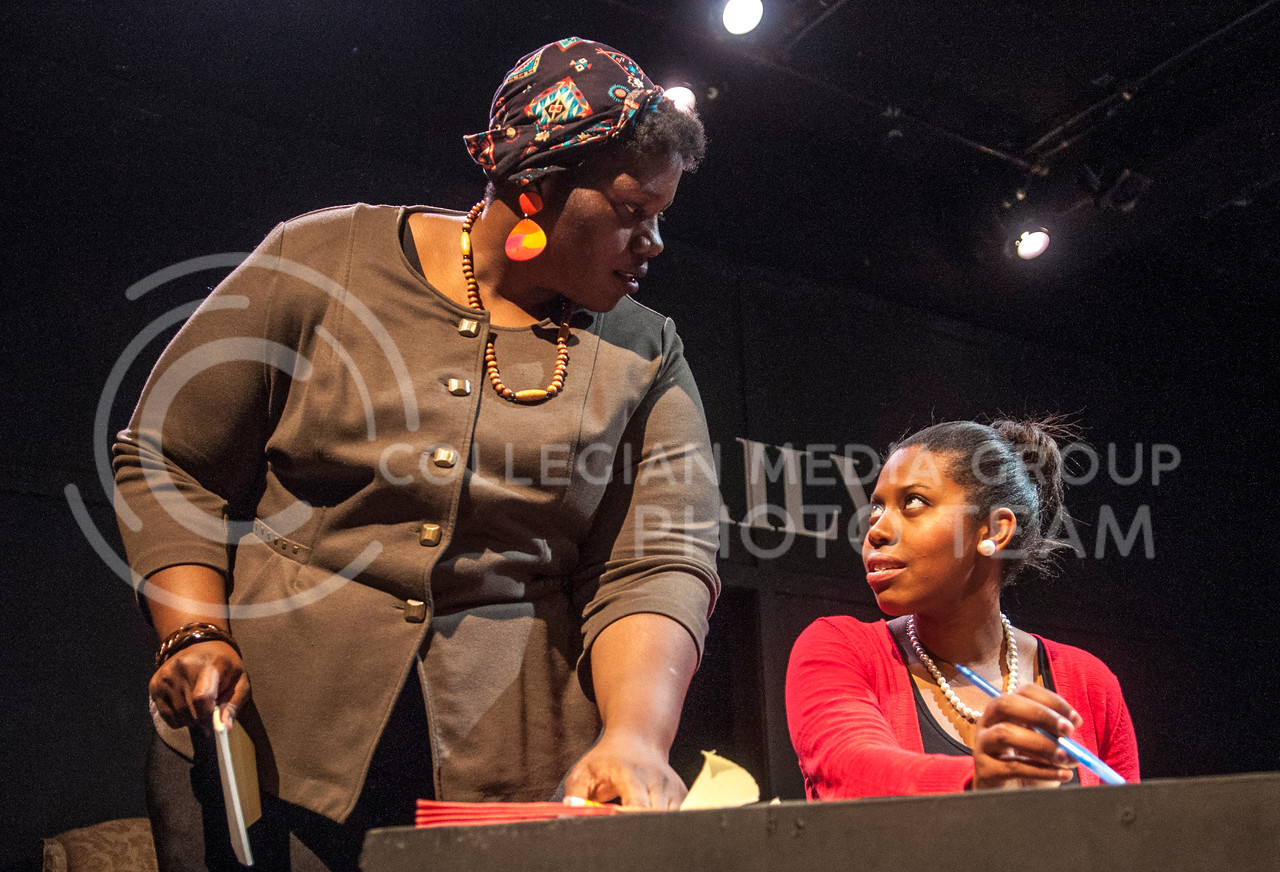 """Hannah Hunsinger   The Collegian<br /> In a dress rehearsal last night, reporter Yvonne, played by Erika Williams, and her editor Patt, played by Angelica McKinnis, don't get along in the play """"The Story"""" performed by the Ebony Theater in Purple Masque Theater.  The story revolves around racial issues and journalistic ethics in a newsroom. It premeirs Feb. 20 in the Purple Masque Theater."""