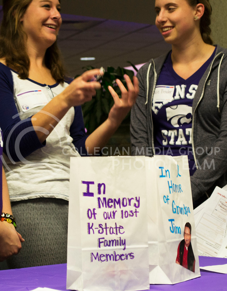 Photo by Lauren Kuykendall | Collegian<br /> <br /> <br /> Freshman, Jessica Van Ranken majoring in Political Science laughs with Natalie Bender, a sophomore in Communication Science & Disorders while helping host the early bird event for Relay for Life. This is a student run organization at K-State to help contribute to fighting against all forms of cancer.