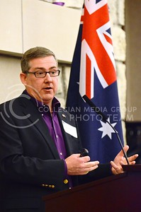 (Photo by Parker Robb | Collegian)  K-State President Kirk Schulz, backdropped by an Australian flag, discusses what the almost three-year-old Australia initiative has done for K-State and several Australia universities, and shares his vision for continuing the program into the future during a reception in the Alumni Center January 26, 2014. The reception also recognized K-State's Australian students on Australia Day.