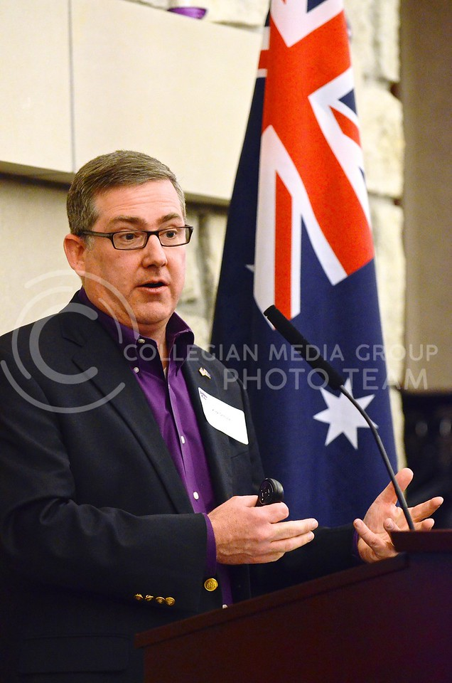 (Photo by Parker Robb | Collegian)<br /> <br /> K-State President Kirk Schulz, backdropped by an Australian flag, discusses what the almost three-year-old Australia initiative has done for K-State and several Australia universities, and shares his vision for continuing the program into the future during a reception in the Alumni Center January 26, 2014. The reception also recognized K-State's Australian students on Australia Day.