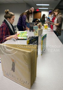 (Photo by Taylor Alderman | Collegian)  Picture books were read, evaulated, and voted on during the Mock Caldecott event at the Manhattan Public Library on December 7, 2013. On a Beam of Light: A Story of Albert Einstein by Jennifer Berne and illustrator Vladimir Radunsky was one of the picture books in the Mock Caldecott.