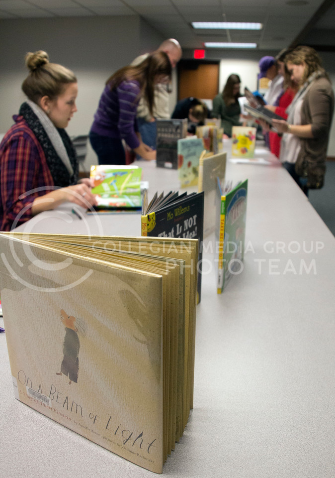 (Photo by Taylor Alderman | Collegian)<br /> <br /> Picture books were read, evaulated, and voted on during the Mock Caldecott event at the Manhattan Public Library on December 7, 2013. On a Beam of Light: A Story of Albert Einstein by Jennifer Berne and illustrator Vladimir Radunsky was one of the picture books in the Mock Caldecott.
