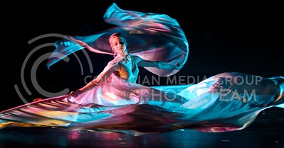 (Photo by Parker Robb | Collegian)  A performer of the group Quixotic lets the differently-colored light flash and play off the sheets of her wings as she performs dance and acrobatics to beating music February 7, 2014, at McCain Auditorium.