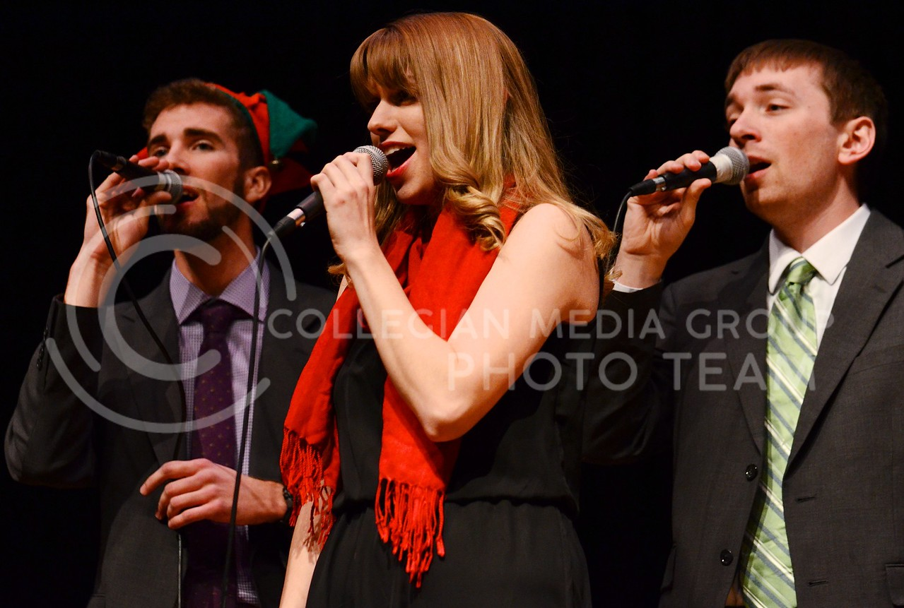 """(Photo by Parker Robb   Collegian)<br /> <br /> Members of the a cappella group In-A-Chord perform NSYNC's arrangement of """"O Holy Night"""" at the Holiday Music Spectacular held in Peace Memorial Auditorium attached to City Hall December 11, 2013. Several musical groups performed in the concert, which was held to raise money to save the Memorial Auditorium, upgrade sound, lighting, seating, and to add a memorial plaque. The city wanted to renovate and convert the auditorium/gymnasium into more office space, but their plans were met with considerable backlash."""