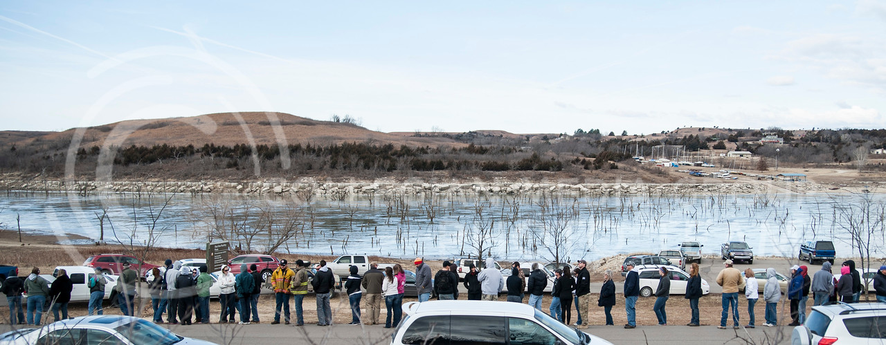 (Photo by Emily DeShazer   The Collegian)<br /> <br /> Volunteers stand in line to be placed in to search groups on Jan. 25, 2014 at the boat docks at Tuttle Creek.  More than 400 people helped search for Jane Peterson, who has been missing for more than a week.