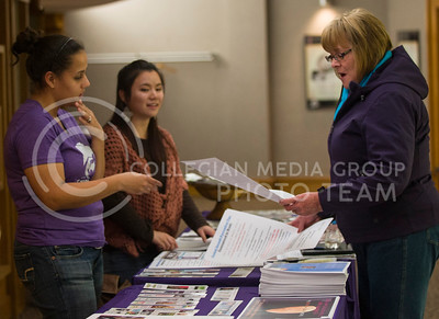 "Emily DeShazer | The Collegian  Student workers Nicole Horn, senior in family studies and human services, and Qiu Wu Hunyh help Beverly Olson, from Manhattan, find materials from the Women's Center. Olson said she went to the ""Art of Rape"" event because she works for Sheppards Crossing and wanted to be able to help and give women hope if she ever encounter someone that needs it."