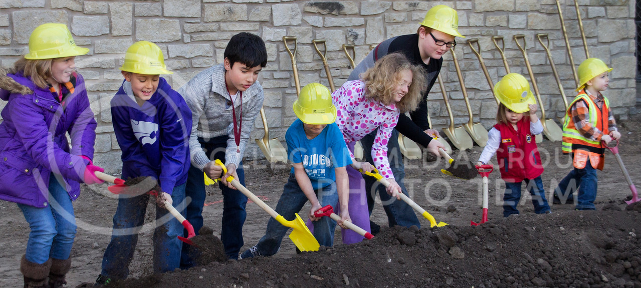 (Photo by Taylor Alderman | Collegian)<br /> <br /> Children shoveling dirt during the groundbreaking ceremony at the Manhattan Public Library on January 25, 2014. The new addition to the library will include expanding the children's library.