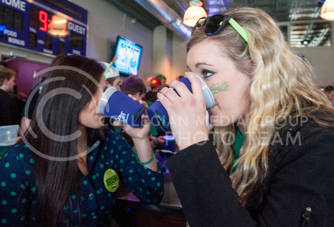 A pair of friends sip beer at Johnny Kaw's on the morning of Fake Patty's Day, Saturday, March 8.
