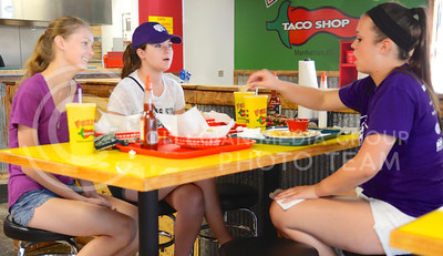 (Photo by Parker Robb | Collegian)  From left to right, Allie Owens, junior in animal science, Abby Thomann, junior in public relations, and Ashley Clark, junior in marketing, enjoy their meal Tuesday evening at Fuzzy's Taco Shop. The restaurant with the funny name recently opened in Aggieville in the property vacated by the Hibachi Hut.