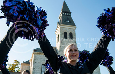(Photo by Hannah Hunsinger   The Collegian)  Katie McNally, sophmore in marketing, performs with the K-State cheerleaders are the closing ceremonies. The closing ceremonies for the yearlong 150th celebration took place on the afternoon of Thursday, Oct. 34, 2013. The event offered 150th merchandise for purchase, free t-shirts, Wildcat 150 Call Hall ice cream, and display of the time capsule contents, an appearnce by Willie, and the performance by members of the marching band.