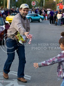 Photo by Jed Barker   The Collegian  The man driving a red corvette during the K-State Homecoming Parade, stops in Aggieville to give out candy to kids lined up along the sidewalks on October 25, 2013.