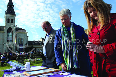(Photo by Josh Staab   The Collegian)  DeeAnna Fugate (Red) and Carla Bishop longtime employees of Kansas State's Financial Services take a look at what's on display at the 150th anniversary celebration.