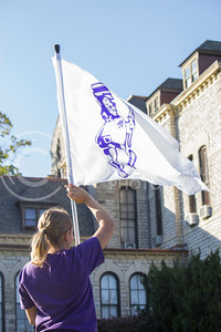 (Photo by Minh Mac   The Collegian)  A color guard raises the Wildcat flag in front of Anderson Hall.  Celebration of the 150th Grand Finale and closing ceremonies reception were held on the Anderson Hall lawn, on Thursday, Oct. 24, 2013. Comers were given free t-shirts, and the special 150 K-birthday flavored Call Hall ice-cream.