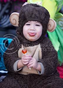 Photo by Jed Barker   The Collegian  Two year old Agam Naylor makes monkey sounds as he enjoys his lolly pop that he got from Trick-or-Treat in Aggieville on October 25, 2013.