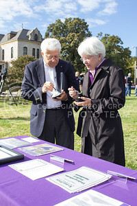 (Photo by Minh Mac   The Collegian)  Larry Erpelding, a 72' alumnus, and his wife Donna Erpelding, a 88' alumnus, enjoy the special 150th bithday flavored Call Hall ice-cream while looking at the K-state Proud table.  Celebration of the 150th Grand Finale and closing ceremonies reception were held on the Anderson Hall lawn, on Thursday, Oct. 24, 2013. Comers were given free t-shirts, and the special 150 K-birthday flavored Call Hall ice-cream.
