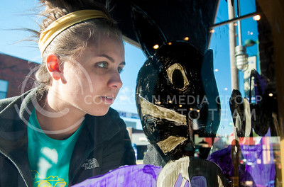 (Photo by Hannah Hunsinger   The Collegian)  Kelsey Nelson, senior in accounting, adds detail to the Powercat Motorsports window painting on Oct. 22, in Aggieville.