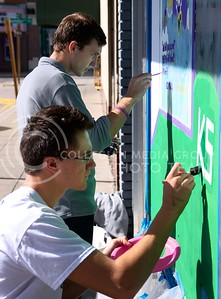 (Photo by Jed Barker   The Collegian)  Samuel McKinney, freshman in agricultural economics and a member of Beta Theta Pi, and Chase Flanders, freshman in advertising and a member of Sigma Alpha Epsilon, paint away during Paint the 'Ville on Tuesday.