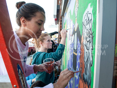 (Photo by Hannah Hunsinger   The Collegian)   Jill Applegate (left), sophmore in journalism and mass communication, and Janelle Headrick, freshman in architecture, paint a Wizard of Oz themed window for Alpha Delta Pi, Alpha Gamma Rho, Alpha Kappa Lambda and Alpha of Clovia, in Aggieville on Oct. 22, 2013.