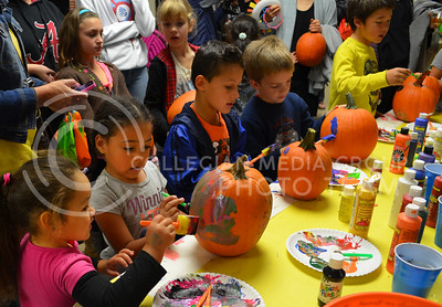 (Photo by Allison Evans   The Collegian)  4 year old Nia Young and her cousin Tierra, also 4, decorate pumpkins thursday night at the children's carnival in the Kansas State Student Union