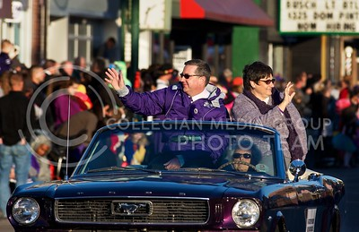 Photo by Jed Barker   The Collegian  K-State President Kirk Schulz and his wife Noel wave at the crowds as they pass through Aggieville during the Home Coming Parade on October 25, 2013.