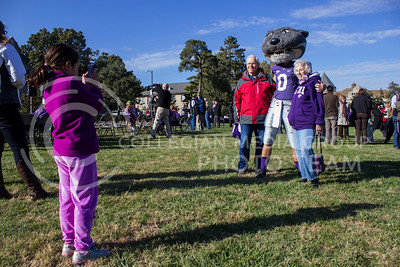 (Photo by Minh Mac   The Collegian)  Frida Gonzalez-Thurston, 7 year-old, takes picture of her grandparents Ron and Barbara Thurston during their visit at K-state.  Celebration of the 150th Grand Finale and closing ceremonies reception were held on the Anderson Hall lawn, on Thursday, Oct. 24, 2013. Comers were given free t-shirts, and the special 150 K-birthday flavored Call Hall ice-cream.