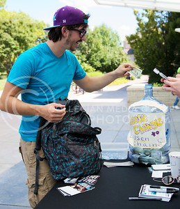 (Photo by Jed Barker | Collegian) Daniel Dorsett, junior in chemical engineering, gladly donates to the iEmpathize campaign on Tuesday at Bosco Plaza.  The iEmpathize campaign seeks to raise awareness and raise financial support for victims of sex trafficking around the world.