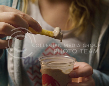 "(Photo by Taylor Alderman | Collegian)  A classic ""weird food combination"" is dipping a Wendy's french fries in a Frosty."