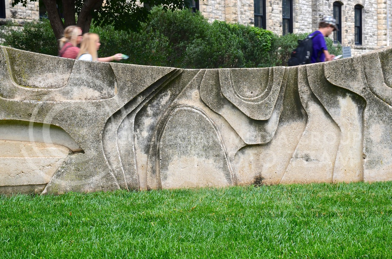"(Photo by Parker Robb | Collegian)  <br /> <br /> Robert Hudson used carved styrofoam on a wood support as mold for this untitled concrete statue, located at the southeast corner of Seaton Hall, which he created through the ""Art in Situation"" workshop in 1969."