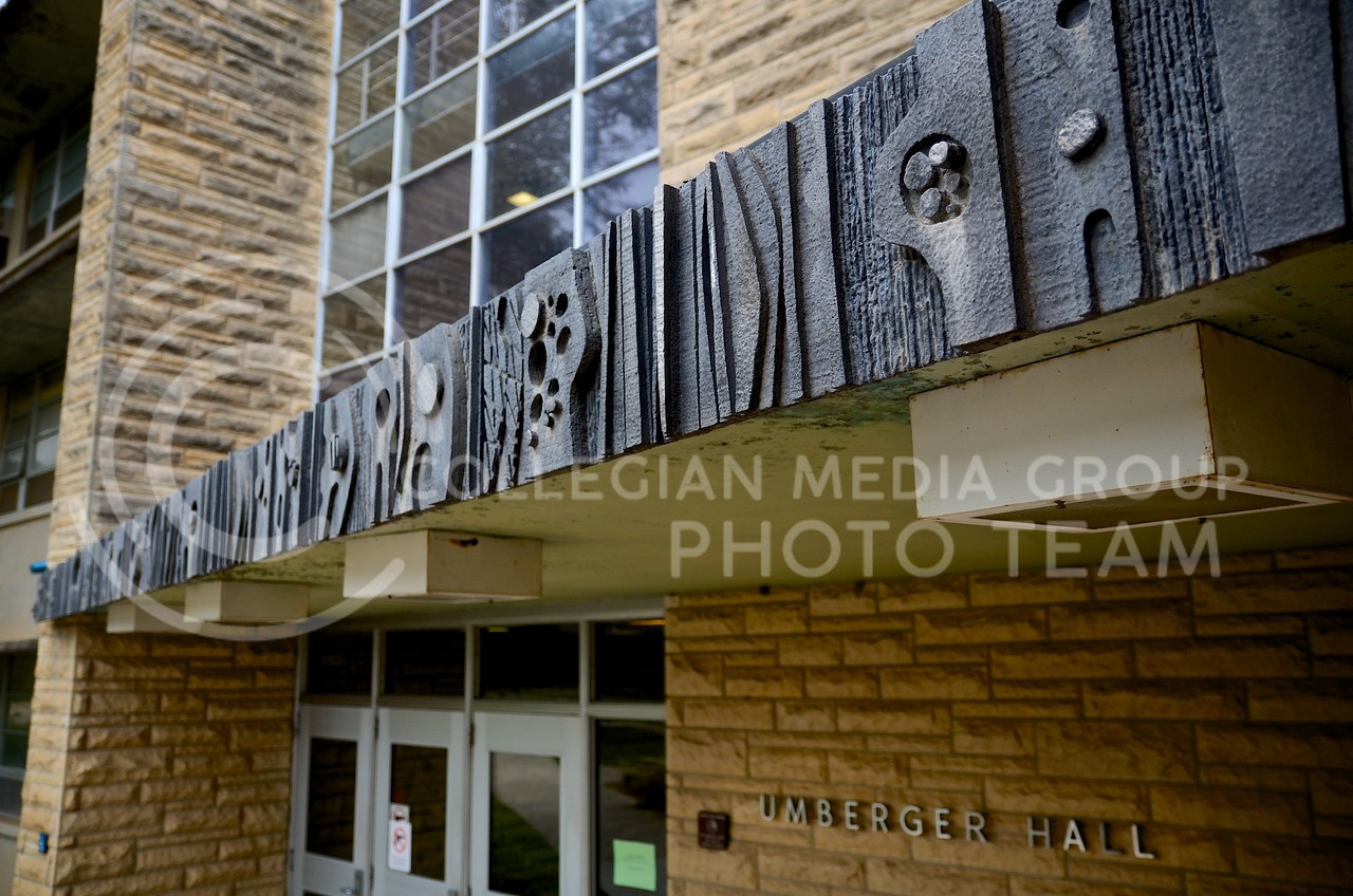 "(Photo by Parker Robb | Collegian)  <br /> <br /> ""Hard Work,"" a cast aluminum sculpture adorning the entrance to Umberger Hall was designed by Barry West in 1969 as part of the ""Art in Situation"" workshop."
