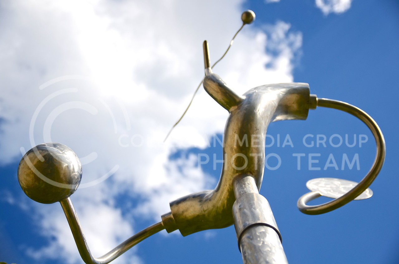 (Photo by Parker Robb | Collegian)  <br /> <br /> John Vogt created this untitled piece, located on the southeast side of the Beach Museum of Art, in 1991 from stainless steel. It was a promised gift from John and Pat Vogt, Mark Vogt and Jamie Kitch.