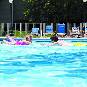 (Photo by Taylor Alderman | The Collegian)  Amie Mumma, senior in hospitality management, and Jake Marlatt, senior in nutrition, laying out on floaties at the University Crossing Pool Party on June 13th, 2014.